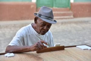 Old man playing domino